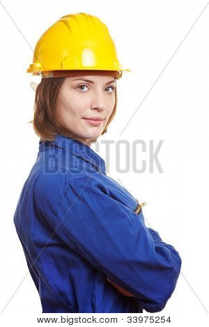 Female builder with blue boiler suit and yellow safety hardhat