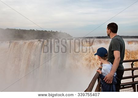 Family Of Two, Father And Son, Enjoying The Gorgeous View Of Devil's Throat Waterfall (garganta Del