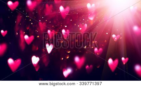 Valentine's Day red Background. Holiday Blinking Abstract Valentine Backdrop with Glowing Hearts. Heart Shape Bokeh. Love concept. Valentines art vivid purple design. Romantic banner design
