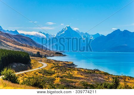 New Zealand. Mount Cook National Park. Magnificent highway runs along mountain lake with azure water to the snow-capped mountains. The concept of active, car and photo tourism