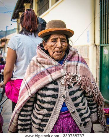 Cusco , Peru- Jan 9, 2019: Old  quechua woman in traditional costum at main street of  Cusco City, Peru.