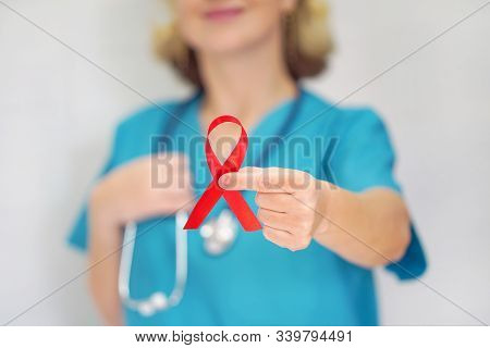 Aid, Hiv Red Ribbon. Symbol Of Awareness, Charity, Support In Disease, Illness, Ill. Aids, Hiv. A Fe