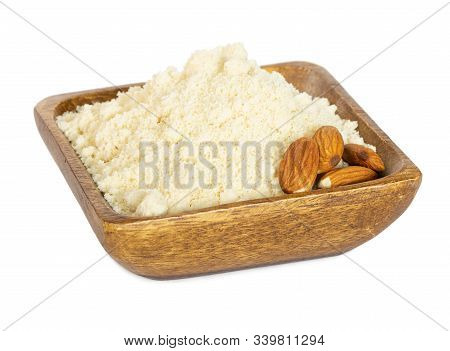 Almond Flour In Wooden Bowl Isolated On White Background.