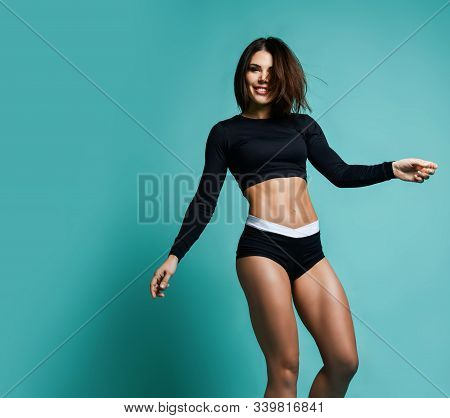 Fitness And Diet Concept. Portrait Of Happy Woman With Perfect Sporty Body And Pretty Flat Abs In Se
