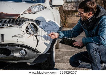 Inspection Of The Car After An Accident On The Road. Car Accident Or Accident. The Front Wing And Th