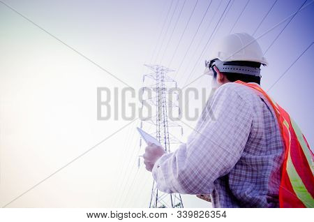 Electrical Engineer Holding And Using A Digital Tablet