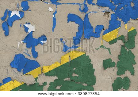 Solomon Islands flag depicted in paint colors on old obsolete messy concrete wall closeup. Textured banner on rough background poster