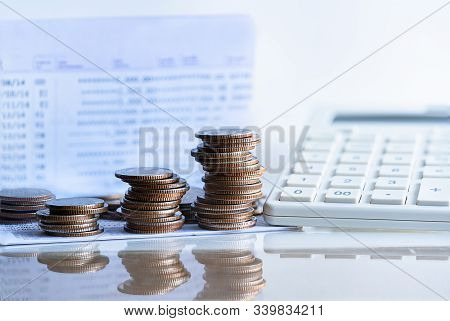 Bank Passbook With Calculator And Stack Money Coin For Growing Your Business. Dividend Payment To In