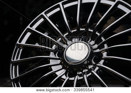 Cast Aluminum Disc Alloy Wheel Modern, Close-up On Black Background, Spokes And Rim