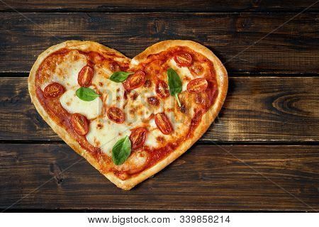 Delicious Heart Shaped Italian Pizza On Wooden Background