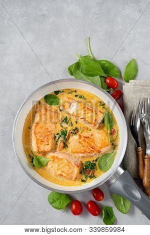 Close Up Of Salmon Peaces In A Frying Pan