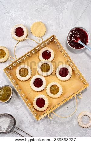 Top View Of Colorful Linzer Cookies On Light Background