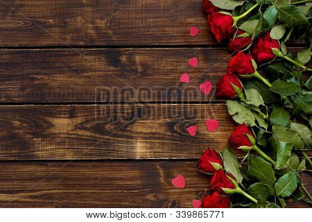 Red Roses On A Dark Wooden Background