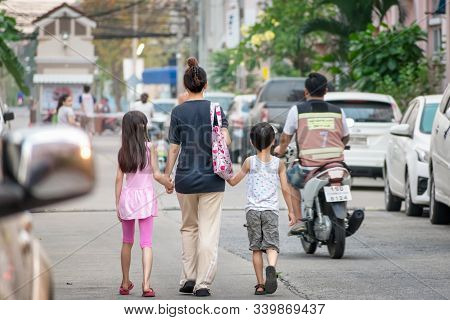 Bangkok, Thailand - December 16: Unnamed Mother With Daughter And Son Walks On The Street In The Nat