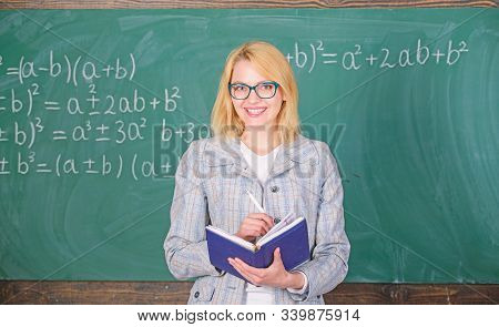 Qualities that make good teacher. Effective teaching involve prioritizing knowledge and skills. Effective teaching involve acquiring relevant knowledge. Woman teaching near chalkboard in classroom poster