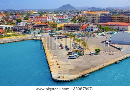 View Of The Main Harbor On Aruba Looking From Cruise Ship, Down Over The City And Boats. Dutch Provi
