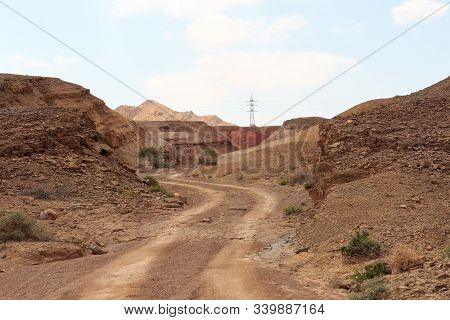 Off-road Path And Mountain In Crater Makhtesh Ramon, Negev Desert, Israel