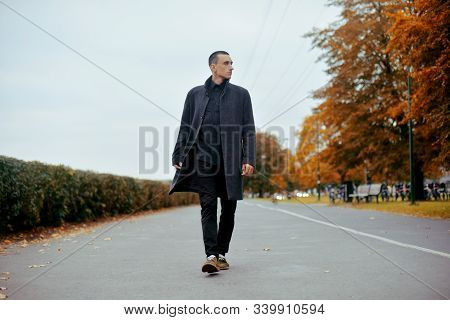 Young Handsome Man In Coat. Fashionable Well Dressed Man Posing In Stylish Coat. Confident And Focus
