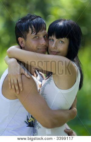 Couple Relax In The Park