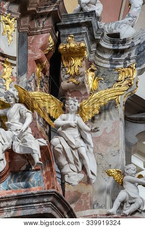 Vilnius, Lithuania - October 26, 2019: Dominican Church Interior Detail With Angels Sculptures. Whit