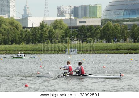 MOSCOW, RUSSIA - JUNE 9: Moscow team in sweep rowing competition in pair boats during 51th International Grand Moscow Regatta in Moscow, Russia on June 9, 2012