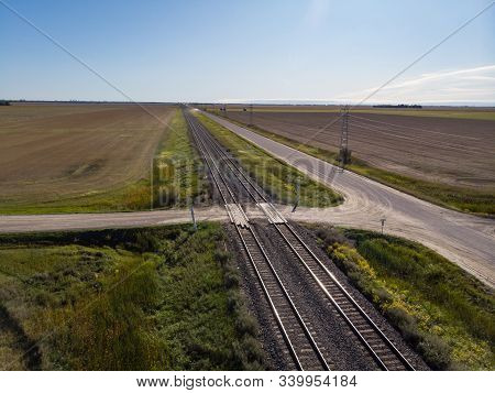 Aerial View Of Double Train Tracks Across Prairie