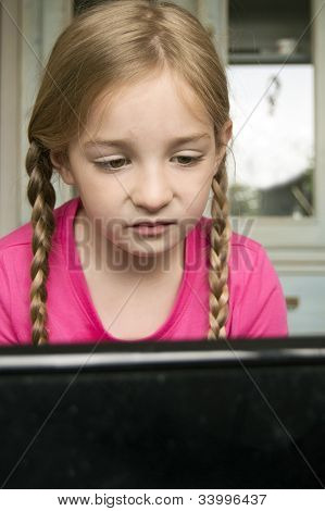 Concentrated Girl At Computer