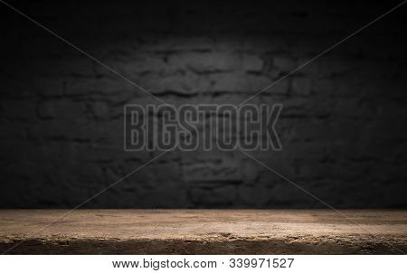 Wood Table In Front Of Rustic Brick Wall Blur Background With Empty Copy Space On The Table For Prod