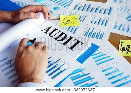 Audit Report In The Blue Folder. Auditing Concept.