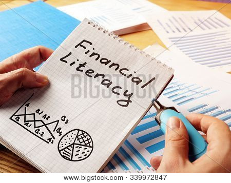 Financial Literacy Handwritten In The Note Pad.
