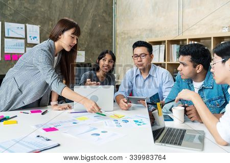 Candid Of Happy Asian Business People Teamwork Are Brainstorming Or Discussion Roadmap Marketing. Le