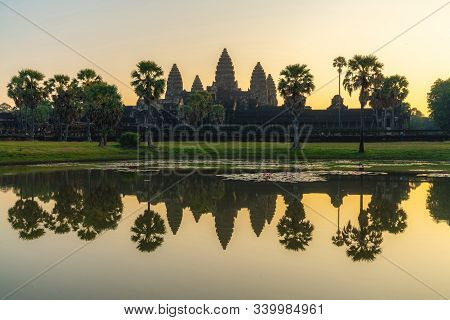 Beautiful View Of Angkor Temple With Sunrise Pastel Color Sky In Morning. Angkor Wat Is A Temple Com
