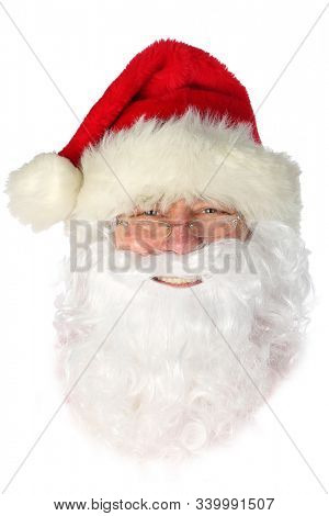 Smiling Santa Claus Head. Santa Claus head with red hat and white beard. Isolated on white. Room for text. clipping path. Merry Christmas and Happy Holidays.