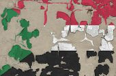 Sudan flag depicted in paint colors on old obsolete messy concrete wall closeup. Textured banner on rough background poster