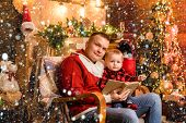 Winter holidays concept. Magic atmosphere family holidays. Fatherhood joy. Enjoy every moment with his son. Spend holidays together. Father and baby son celebrate christmas at home. Adore his son. poster