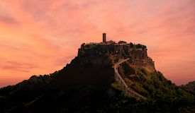 A Suggestive View Of The Town Of Civita Bagnoregio At Sunset Perched On A Crumbling Rock Spur