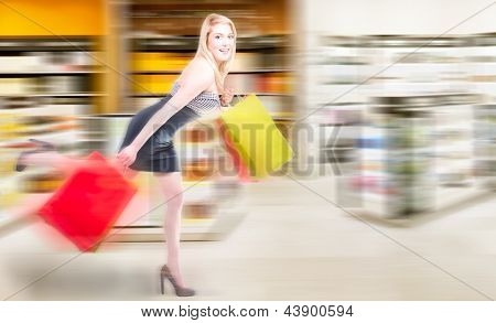 Blonde Woman Running In A Shopping Spree
