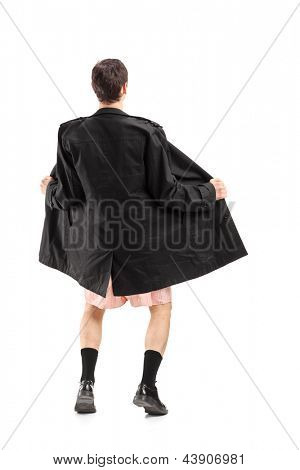 Full length portrait of a flasher wearing coat and gesturing isolated on white background