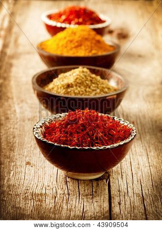 Spices Curry, Saffron, turmeric. Spice over Wood