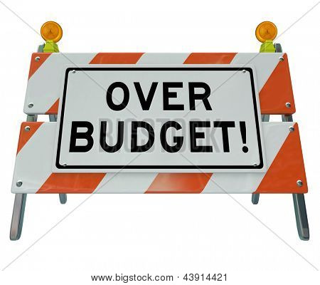 A road construction barrier with the words Over Budget to symbolize financial danger and overspending