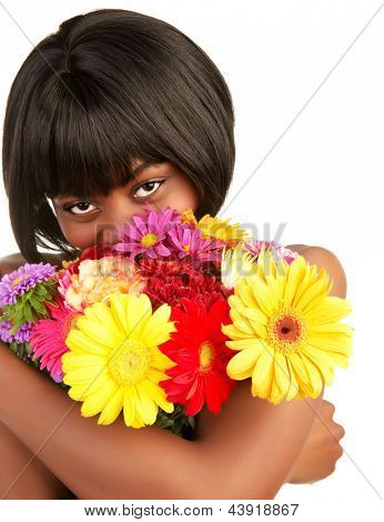 Cheerful black female enjoying sweet flowers smell, cute african girl with great colorful bouquet isolated on white background