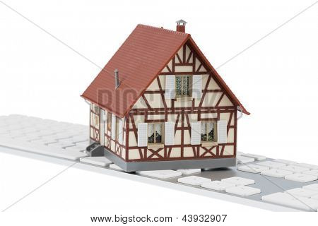 house on keyboard symbol photo for house purchase and rental on the internet