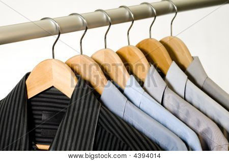 Dress Shirts On Hangers.
