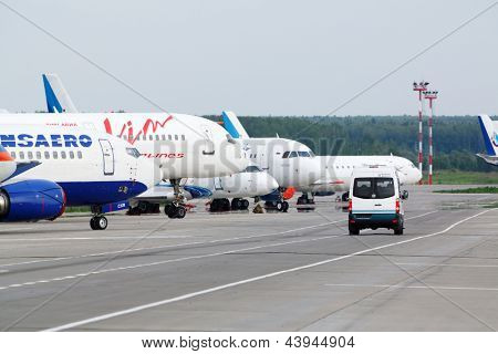 MOSCOW - MAY 22:  Airplanes of various airlines and airdrome car at Domodedovo airport, May 22, 2012, Moscow, Russia. Domodedovo airport - largest and most modern airport in Russia.