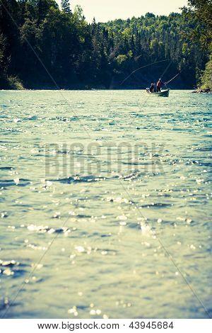 Fishermen Fly Fishing The Salmon