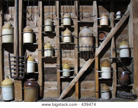 Clay Bottles On Wall