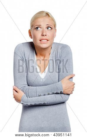 Half-length portrait of freezing woman , isolated on white