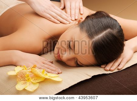 poster of picture of woman in spa salon lying on the massage desk