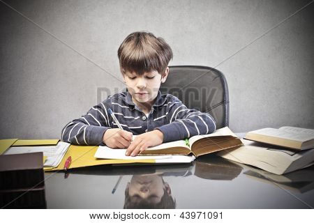 little child writing at the desk