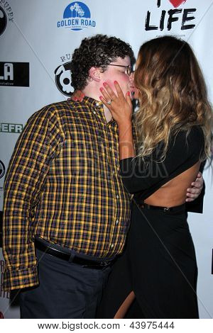 LOS ANGELES - APR 2:  Jesse Heiman, Jasmine Dustin arrives at  the No Kill L.A. Charity Event at the Fred Segal on April 2, 2013 in West Hollywood, CA